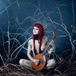 Pale forest spirit girl with musical instrument — Stock Photo