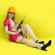 Sexy girl with drill — Stock Photo