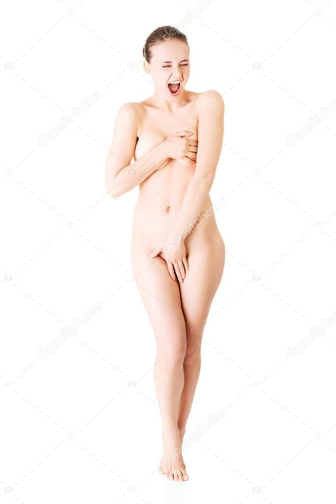 stock photo naked young woman covering herself