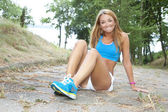 Sportswoman in city park. Woman outside jogging — Stock Photo