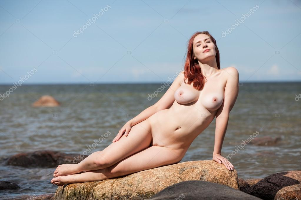 Nude Woman Sitting On Stone Stock Image