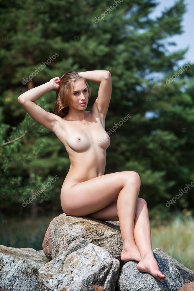Nude Woman Sitting On Stones