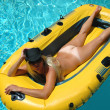 Pretty blond in pool — Stock Photo