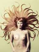 Beautiful nude woman with magnificent hair — Stock Photo