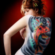 The girl and the red carp (body art) — Stock Photo