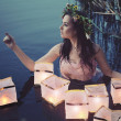 Стоковое фото: Young woman with lanterns