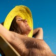 Young naked woman sunbathing outdoors — Stock Photo