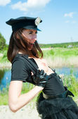 Sexy police woman bared breast on road — Stock Photo