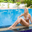 Stock Photo: Woman relaxing in swimming pool