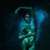 Artistic low contrast nude woman blue dust — Stock Photo