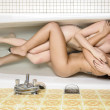 Stock Photo: Two Girl in Bath Tube