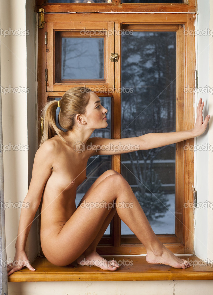 Naked Girl On The Windowsill Young Woman Stockfoto