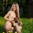 Nude girl with a puppy. — Stock Photo