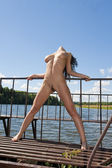 Naked woman on the dam. — Foto de Stock