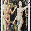 EQUATORIAL GUINEA - CIRCA 1974: A stamp printed in Guinea dedicated to the female nude in art history shows Adam and Eve in paradise by Roger Van der Goes, circa 1974 — Stock Photo