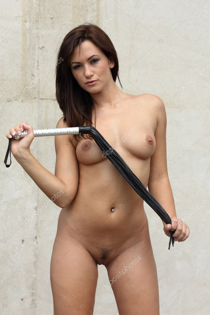 Natural Looking Very Sey Nude Woman Holding A Whip In Her Hands