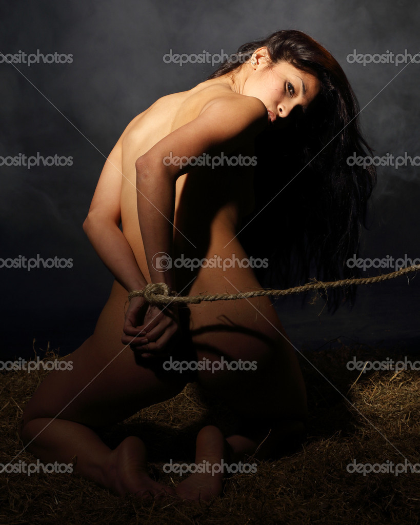 Beautiful Nude Woman In Slave Position Bound A Dungeon
