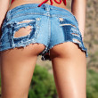 Tiny denim booty shorts — Stock Photo