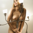 Nude woman and lamp. — Stock Photo