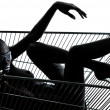 Woman naked in a caddy shopping cart — Stock Photo #33509213