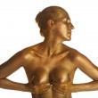 Nude girl bodyart painted in gold on white background — Stock Photo
