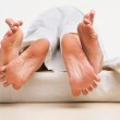 Feet of couple making love — Stock Photo
