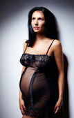 Sensual pregnant woman in nightie — Stock Photo