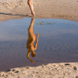 Stock Photo: Reflection of young naked woman