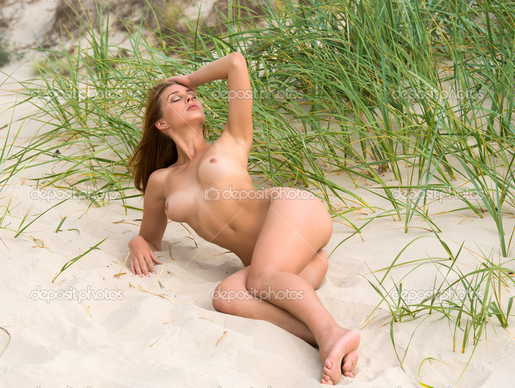 stock photo young nude woman sunbathing