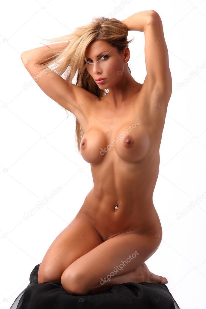 Sey Rubia Tetona Posando A Desnuda En Un Taburete Imagen De Stock
